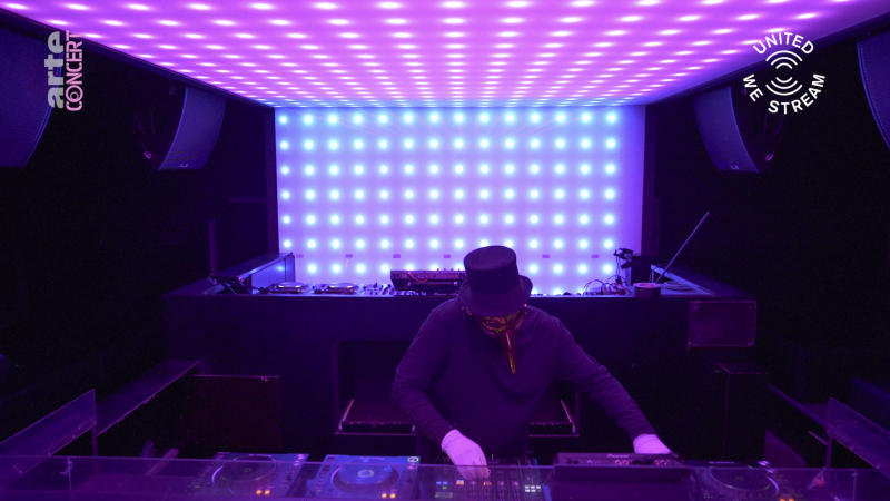 """In this March 18, 2020, frame from video provided by Rundfunk Berlin-Brandenburg, DJ Claptone performs a set as part of the """"United We Stream"""" event at the club Watergate in Berlin. Berlin's nightclubs were closed March 13 to help slow the spread of the virus. In response, some of them formed a streaming platform to let DJs, musicians and artists continue performing. (Rundfunk Berlin-Brandenburg via AP)"""