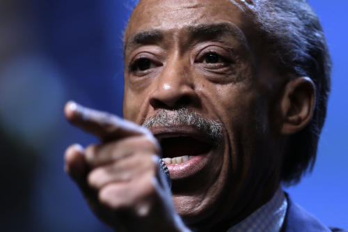 "File- This July 26, 2013 file photo shows the Rev. Al Sharpton gestures as he takes part in a panel discussion during the National Urban League's annual conference in Philadelphia. Sharpton is threatening to boycott luxury retailer Barneys over allegations by shoppers that they were racially profiled there. Sharpton said Saturday Oct. 26, 2013, that black New Yorkers ""are not going to live in a town where our money is considered suspect and everyone else's money is respected."" (AP Photo/Matt Rourke, File)"