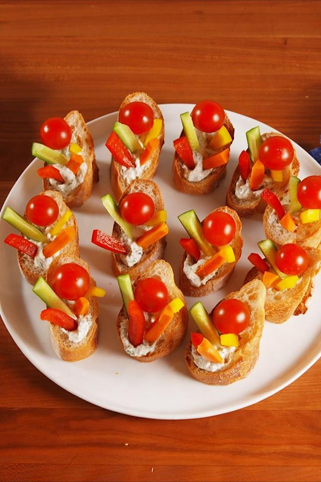 "<p>These handheld cuties are a perfect party snack.</p><p>Get the recipe from <a href=""https://www.delish.com/cooking/recipe-ideas/recipes/a52751/crudite-cups-recipe/"" target=""_blank"">Delish</a>.</p>"