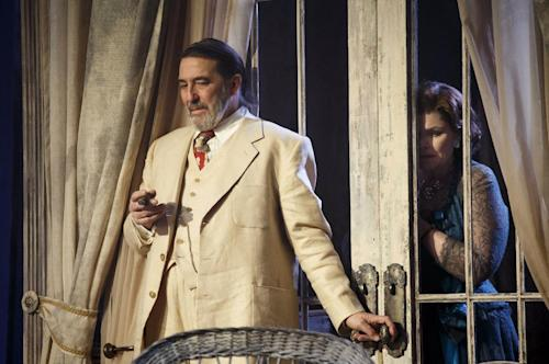 """This undated theater image released by Boneau/Bryan-Brown shows Ciaran Hinds, left, and Debra Monk during a performance of """"Cat on a Hot Tin Roof,"""" playing at the Richard Rodgers Theatre in New York. (AP Photo/Boneau/Bryan-Brown, Joan Marcus)"""