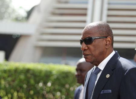 FILE PHOTO: Guinea's President Alpha Conde attends the opening of the 54th Ordinary Session of the ECOWAS Authority of Heads of State and Government, in Abuja