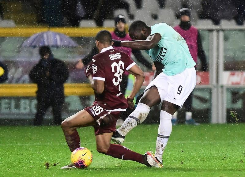 Lukaku strikes again as Inter swamp Torino in torrential rain