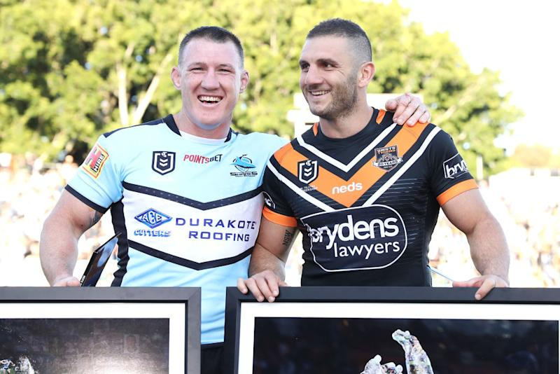 Paul Gallen of the Sharks and Robbie Farah of the Tigers pose after a presentation for playing their final round matches before retirement in the round 25 NRL at Leichhardt Oval on September 08, 2019 in Sydney, Australia. (Photo by Mark Kolbe/Getty Images)