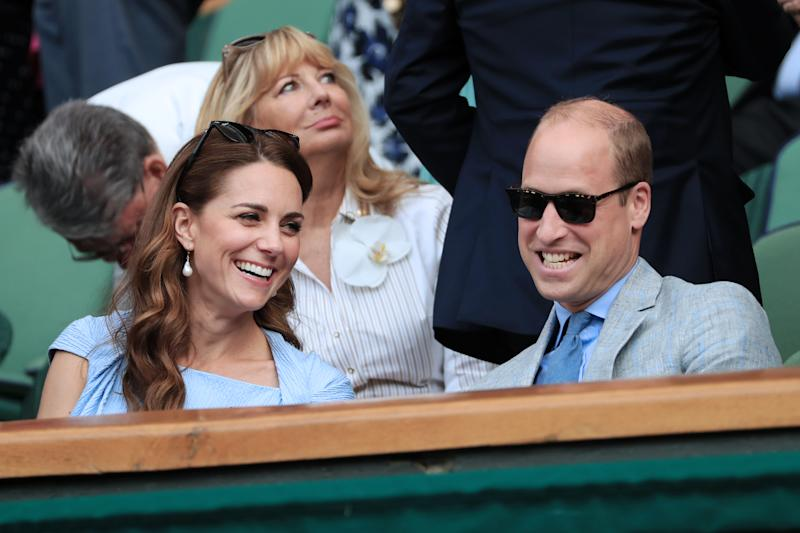 LONDON, ENGLAND - JULY 14: Prince William, Duke of Cambridge speaks to his wife, Catherine, Duchess of Cambridge in the Royal Box on Centre Court on Day 13 of The Championships - Wimbledon 2019 at the All England Lawn Tennis and Croquet Club on July 14, 2019 in London, England. (Photo by Simon Stacpoole/Offside/Getty Images)