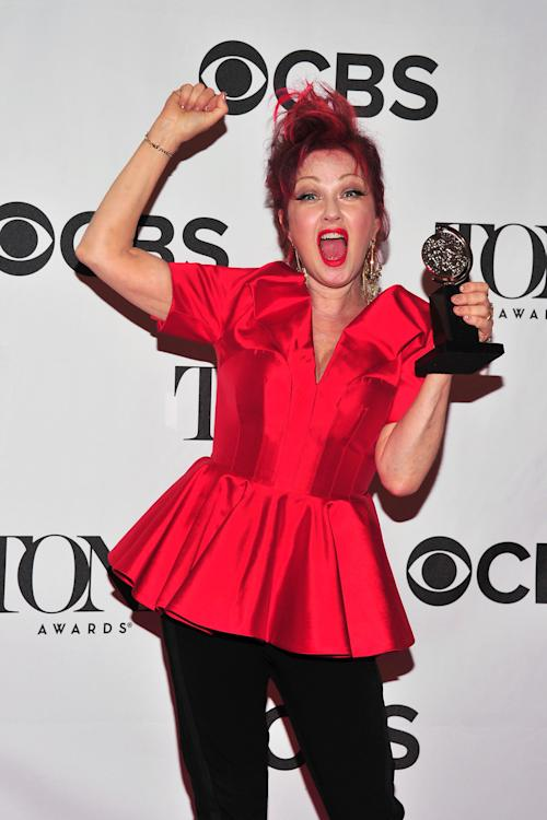 "Cyndi Lauper poses with her award for best musical score for ""Kinky Boots"" in the press room at the 67th Annual Tony Awards, on Sunday, June 9, 2013 in New York. (Photo by Charles Sykes/Invision/AP)"