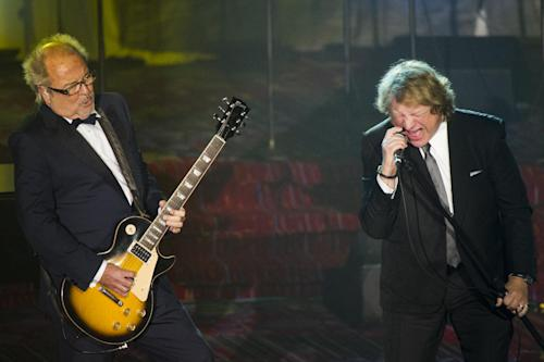 Mick Jones, left, and Lou Gramm from the band Foreigner perform at the Songwriters Hall of Fame 44th annual induction and awards gala on Thursday, June 13, 2013 in New York. (Photo by Charles Sykes/Invision/AP)