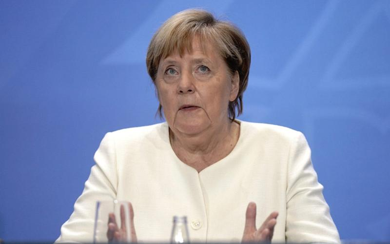 German Chancellor Angela Merkel attends a press conference after a video conference with State Premiers on the country's response to the new coronavirus pandemic on September 29, 2020 in Berlin. (Photo by Kay Nietfeld / POOL / AFP) (Photo by KAY NIETFELD/POOL/AFP via Getty Images) - KAY NIETFELD/AFP