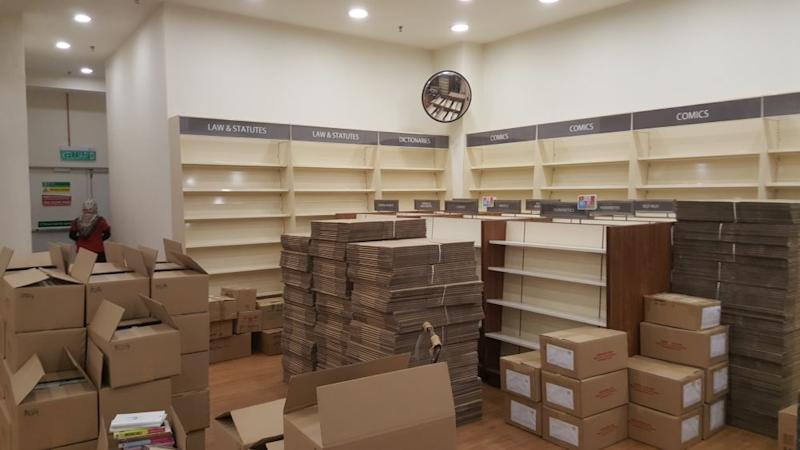 Empty shelves and stacks of boxes loaded with books and stationary are pictured as the MPH MyTown bookstore prepares to close this Saturday, June 6, 2020. — Picture by R. Loheswar