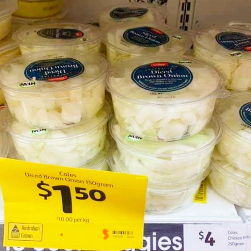 Containers of pre-diced onions sit on a shelf at Coles, with a bright yellow price tag reading $1.50.