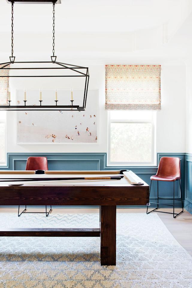 "<p>In terms of décor, recreation rooms can often be an afterthought. Designer Kate Lester encourages homeowners to tackle these spaces with the same discerning eye they'ed use in decorating any area of the home. </p><p>""I know it's common to think that a recreation room should have a theme. But please, please, try to avoid one at all costs. Instead go for something broader and more universal, like 'dark and masculine' or 'neutral and nautical,'"" says Lester. ""This way, you have some leeway to expand and build on the look, and are not tied to a specific narrative. Your home is not a theme party, so remember to keep it comfortable, curated, and chic!"" </p><p><strong>See more at <a href=""https://katelesterinteriors.com"" target=""_blank"">Kate Lester Interiors</a>. </strong></p>"