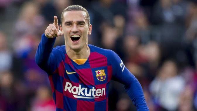 Penyerang Barcelona, Antoine Griezmann, melakukan selebrasi usai membobol gawang UD Ibiza. (AP/Joan Monfort)