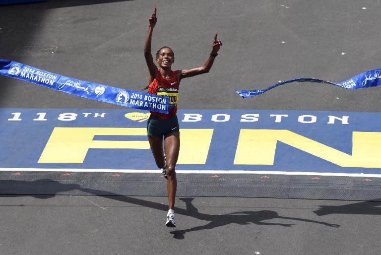 Rita Jeptoo of Kenya crosses the finish line to win the Women's Elite division of the 118th Boston Marathon on April 21, 2014