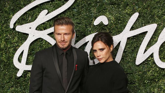 David dan Victoria Beckham di karpet merah British Fashion Awards 2014, London, Inggris. (JUSTIN TALLIS / AFP)