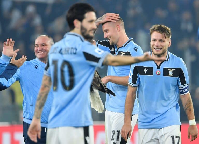 Serie A top scorer Ciro Immobile (R) scored his 27th league goal this season
