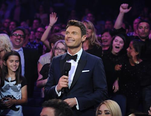 "FILE - In this May 16, 2013 file image released by Fox, host Ryan Seacrest appears during the season 12 finale of ""American Idol,"" in Los Angeles. NBC says Ryan Seacrest will host ""The Million Second Quiz,"" a new live game show the network hopes will become event programming for two weeks in September. (AP Photo/Fox, Ray Mickshaw, File)"