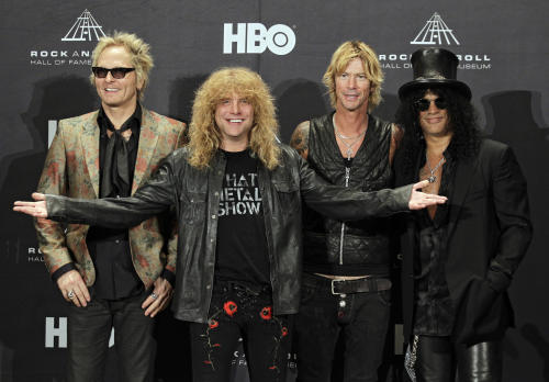 Guns N' Roses, from left: Matt Sorum, Steven Adler, Duff McKagan and Slash appear in the press room after induction into the Rock and Roll Hall of Fame Saturday, April 14, 2012, in Cleveland. (AP Photo/Amy Sancetta)