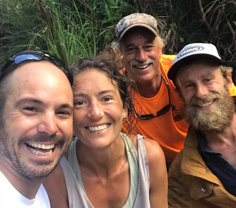 Amanda Eller, a hiker missing in the Maui forest in Hawaii for more than two weeks, poses for a photo with her rescuers – Javier Cantellops, Troy Helmer and Chris Berquist.