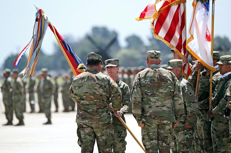 Laura L. Yeager, second from left, is joined by Adjutant General, California Military Department David S. Baldwin, left, during Change of Command Ceremony for the 40th Infantry Division, at the Joint Forces Training Base in Los Alamitos, on June 29, 2019. | Raul Roa—Los Angeles Times