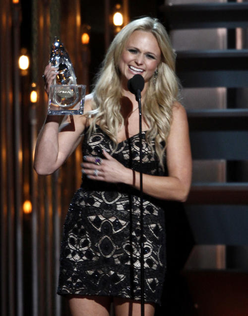 Miranda Lambert accepts the award for female vocalist of the year at the 47th annual CMA Awards at Bridgestone Arena on Wednesday, Nov. 6, 2013, in Nashville, Tenn. (Photo by Wade Payne/Invision/AP)