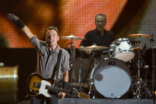 FILE - In this Sept. 22, 2013 file photo, Bruce Springsteen performs during the Rock in Rio music festival in Rio de Janeiro. Springsteen will headline the NCAA March Madness Music Festival next month in Dallas. (AP Photo/Felipe Dana, File)