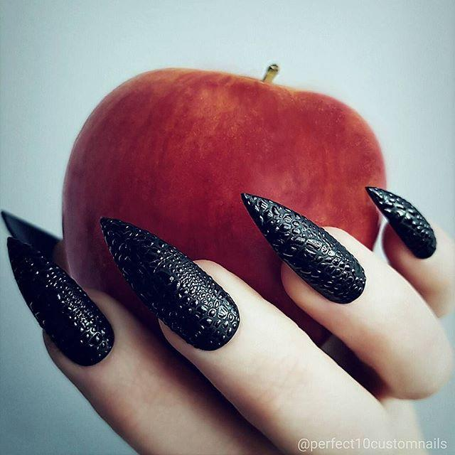 """<p>Textured nail stickers upgrade a black manicure into a witchy new look.<strong></strong><strong></strong></p><p><a class=""""body-btn-link"""" href=""""https://www.amazon.com/76-5cm-Decals-Sticker-Marble-Decorations/dp/B07RNCMS5W/?tag=syn-yahoo-20&ascsubtag=%5Bartid%7C10055.g.1421%5Bsrc%7Cyahoo-us"""" target=""""_blank"""">SHOP SNAKE NAIL STICKERS</a></p><p><strong>RELATED:</strong> <a href=""""https://www.goodhousekeeping.com/holidays/halloween-ideas/g2599/halloween-costumes-with-makeup-ideas/"""" target=""""_blank"""">45 Best Halloween Makeup Ideas to Easily Elevate Your Costume</a></p><p><a href=""""https://www.instagram.com/p/B4-j8j9ojO_/&hidecaption=true"""">See the original post on Instagram</a></p>"""