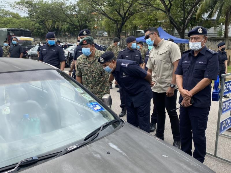 Johor police chief Datuk Ayob Khan Mydin Pitchay (third from left) and Brigadier General Datuk Zawawi Adam (second left) during a joint police and military roadblock in Tampoi, Johor Baru March 23, 2020. — Picture by Ben Tan