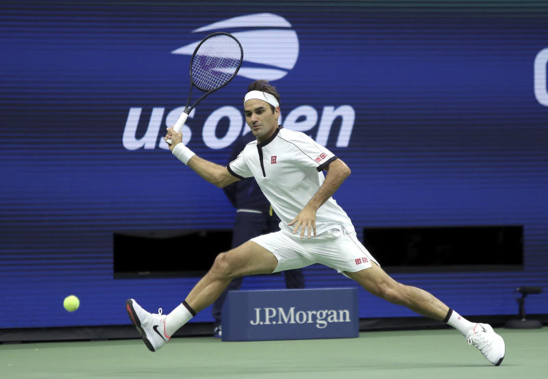FILE - In this Aug. 28, 2019, file photo, Roger Federer, of Switzerland, returns a shot to Damir Dzumhur, of Bosnia, during the second round of the US Open tennis championships in New York. Federer will be competing in the Australian Open tennis tournament beginning Monday, Jan. 20, 2020. (AP Photo/Eduardo Munoz Alvarez, File)