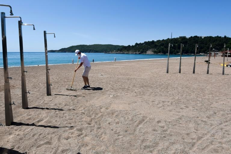 In spite of the absence of tourists the staff have been raking the beaches in Montenegro, preparing for a possible late rush