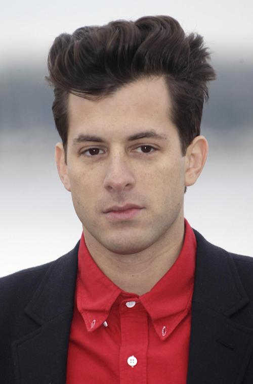 """FILE - British music producer and artist Mark Ronson poses at the 46th MIDEM (International record music publishing and video music market) in Cannes, southern France, in this Jan. 30, 2012 file photo. Ronson went from being the DJ at Paul McCartney's wedding to producing for the icon in the studio. Ronson said in an interview Thursday March 21, 2013 that he worked on three songs with the former Beatles singer. He called the process """"insane."""" (AP Photo/Lionel Cironneau, File)"""
