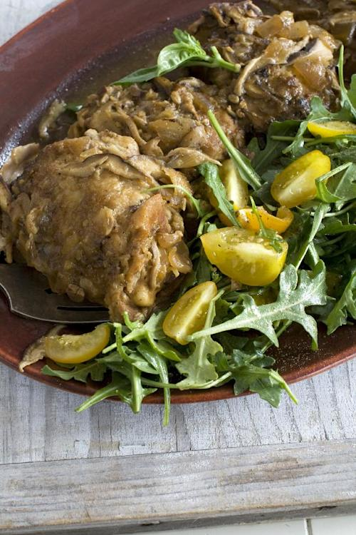 This March 25, 2013 photo taken in Concord, N.H. shows a recipe for miso-smothered chicken with a side salad. (AP Photo/Matthew Mead)