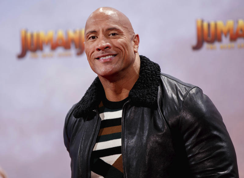 """September 2nd 2020 - Dwayne The Rock Johnson, his wife Lauren Hashian and his two youngest daughters Jasmine and Tiana have tested positive for the coronavirus. - File Photo by: zz/KGC-324-RC/STAR MAX/IPx 2019 12/4/19 Dwayne The Rock Johnson at the premiere of """"Jumanji: The Next Level"""" held on December 4, 2019 in Berlin, Germany."""