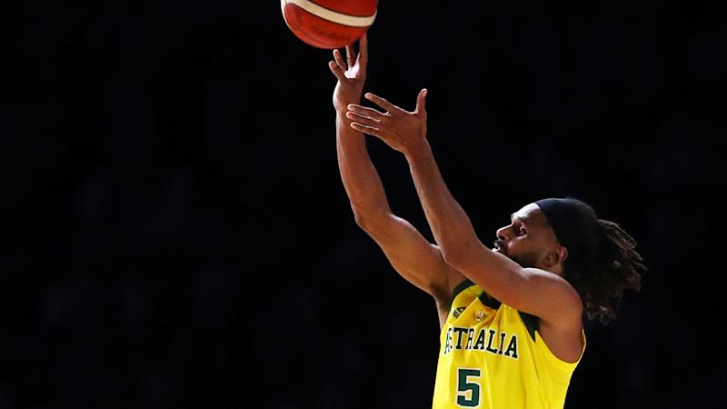 Patty Mill, pictured shooting a three, was key to the Boomers' historic win over Team USA.