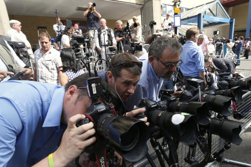 Photographers adjust their camera's outside St. Mary's Hospital exclusive Lindo Wing in London, Monday, July 22, 2013. Buckingham Palace officials say Prince William's wife, Kate, has been admitted to the hospital in the early stages of labour. Royal officials said that Kate traveled by car to St. Mary's Hospital in central London. Kate, also known as the Duchess of Cambridge, is expected to give birth in the private Lindo Wing of the hospital, where Princess Diana gave birth to William and his younger brother, Prince Harry.The baby will be third in line for the British throne, behind Prince Charles and William, and is anticipated eventually to become king or queen. (AP Photo/Lefteris Pitarakis)