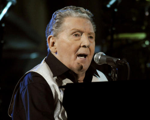 "FILE - In this Oct. 30, 2009 file photo, Jerry Lee Lewis performs at the 25th Anniversary Rock & Roll Hall of Fame concert at Madison Square Garden in New York. Lewis has married for a seventh time in Mississippi, and the new bride is his cousin's ex-wife. The Adams County circuit clerk's office said the marriage license shows Lewis was married March 9 to Judith Ann Coghlan Brown. The 76-year-old Lewis, also known as ""The Killer,"" is famous for hits like ""Great Balls of Fire"" and ""Whole Lotta Shakin' Goin' On."" (AP Photo/Henny Ray Abrams, file)"