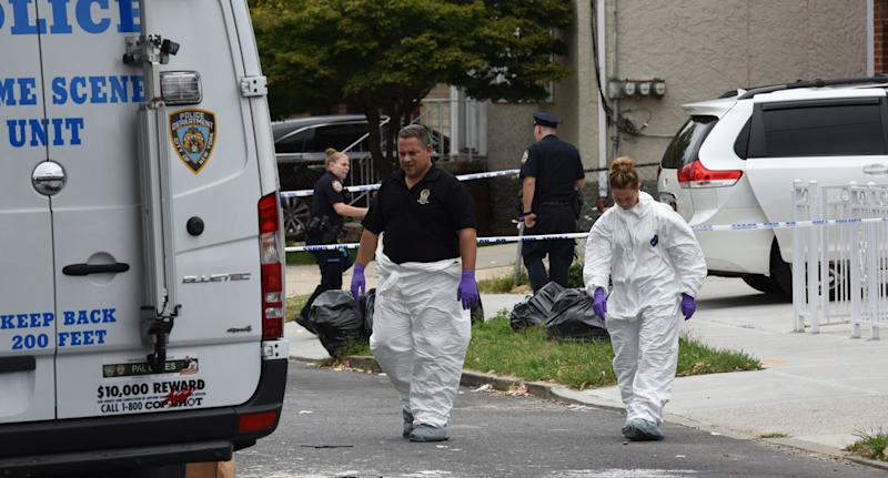Investigators on the scene at the unlicensed childcare centre in Queens, New York, which was being run as an unlicensed childcare centre. Three babies were stabbed. Source: Getty Images