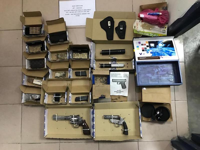 The seized ammunition, bullets and guns. — Picture courtesy of PDRM