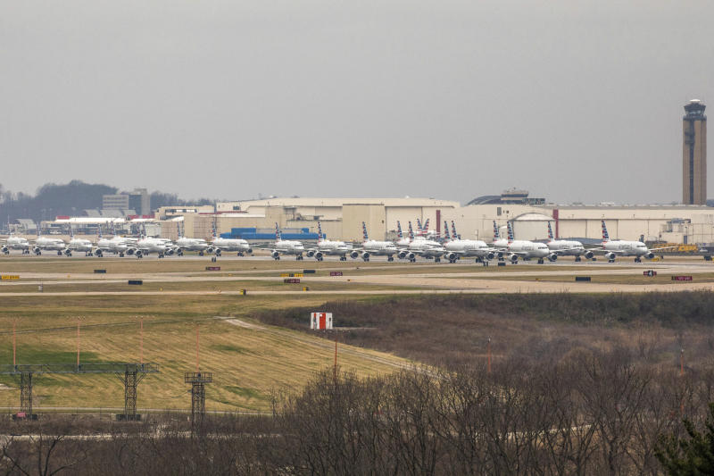Dozens of parked American Airlines planes are parked at the Pittsburgh International Airport, Friday, March 27, 2020, in Moon, Pa. The airport has become a parking destination for the airline during the COVID-19 shutdown. (Andrew Rush/Pittsburgh Post-Gazette via AP)