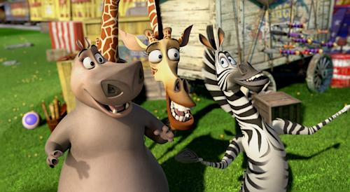 """This film image released by DreamWorks Animation shows, Gloria the Hippo, voiced by Jada Pinkett Smith, left, Melman the Giraffe, voiced by David Schwimmer, center, and Marty the Zebra, voiced by Chris Rock, in a scene from """"Madagascar 3: Europe's Most Wanted."""" (AP Photo/DreamWorks Animation - Paramount Pictures)"""