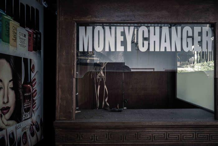 An empty money changer booth in Kuta, Bali, Indonesia.