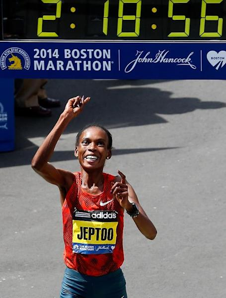 Rita Jeptoo of Kenya crosses the finish line to win the 118th Boston Marathon on April 21, 2014 in Boston, Massachusetts