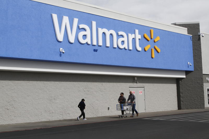 People shop at the Cielo Vista Walmart in El Paso Thursday, Feb. 6, 2020, in El Paso, Texas, where 22 people were murdered last August. Department of Justice are expected to announce Thursday that the suspected shooter Patrick Crusius will be charged with federal hate crimes, in addition to the state capital murder charges he already faces. (AP Photo/Cedar Attanasio)