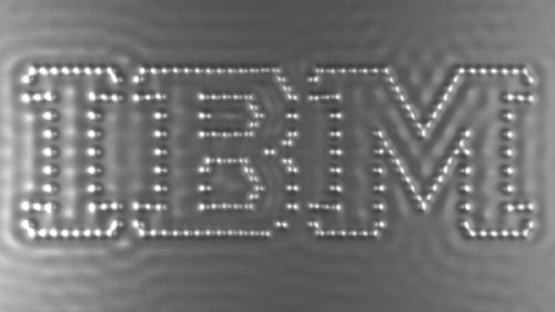 """In this undated image taken from video and provided by IBM, carbon monoxide molecules are arranged on the screen to form the IBM logo, in what IBM claims to be the world's tiniest stop-action movie. Entitled """"A Boy and his Atom,"""" the one minute video employs individual carbon monoxide molecules that are rearranged to show a boy carrying out various activities. Each of the 242 frames measures 45 by 25 nanometers which is one billionth of a meter. (AP Photo/IBM)"""