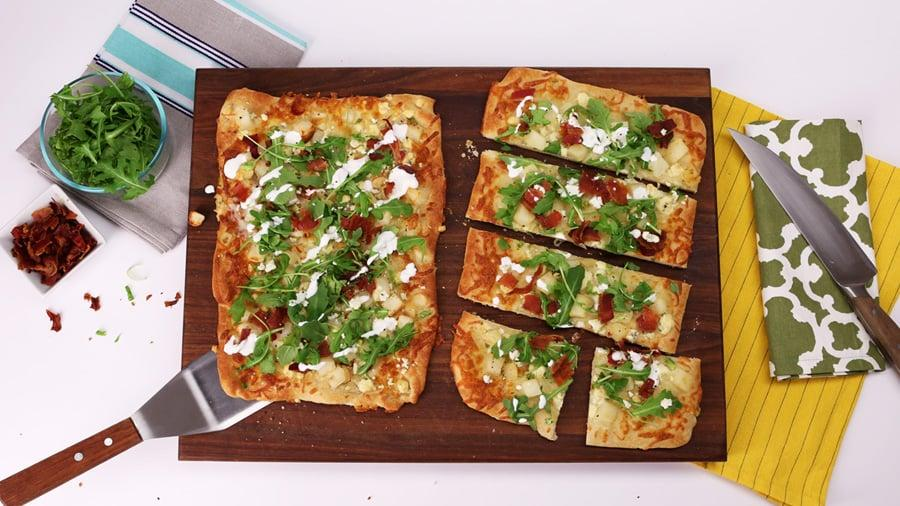"""<p><strong>Get the recipe</strong>: <a href=""""https://www.popsugar.com/food/Bacon-Blue-Cheese-Flatbread-Recipe-Video-33346122"""" class=""""ga-track"""" data-ga-category=""""Related"""" data-ga-label=""""http://www.popsugar.com/food/Bacon-Blue-Cheese-Flatbread-Recipe-Video-33346122"""" data-ga-action=""""In-Line Links"""">bacon, arugula, and blue cheese flatbread</a></p>"""