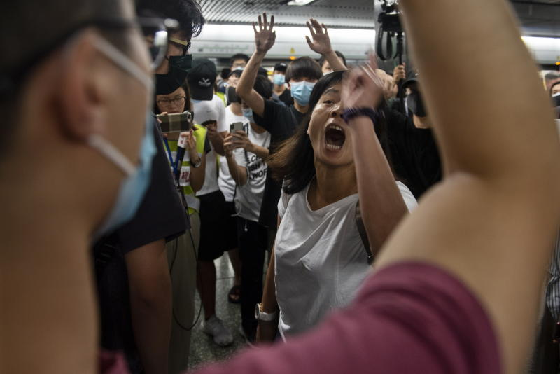 Protesters and commuters clash on a Mass Transit Railway (MTR) subway train as protesters disrupt services by preventing train doors from closing in Diamond Hill MTR station, Hong Kong.