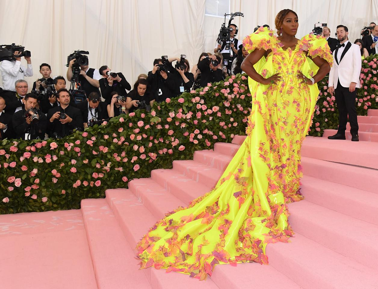 Tennis superstar and co-chair of this year's gala, Serena Williams stepped out in a custom neon yellow strong-shouldered Versace gown with pink feathered detailing and a leaf appliqué. She matched the show-stopping look with yellow Nike sneakers before joining husband, Alexis Ohanian, who called himself a 'proud husband tonight'. Photo: Getty Images