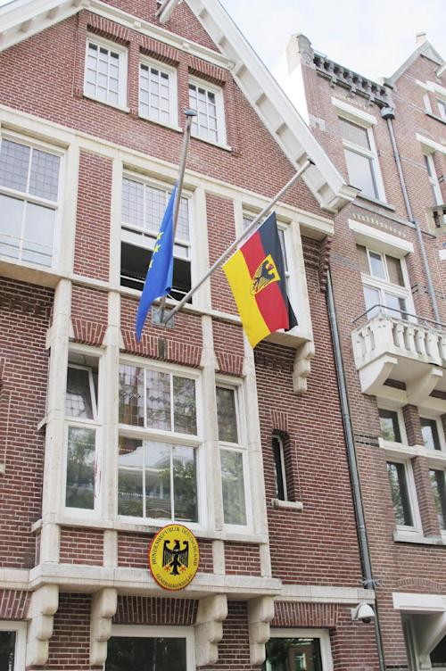 A German flag and a European flag are flying at half-staff at the German Consulate-General in Amsterdam, Friday, Aug. 16, 2013. Members of the Dutch royal family and a small collection of friends are attending a private funeral for Prince Friso, who died this week due to complications from a 2012 skiing accident. He died on Monday, aged 44. Flags are flying at half-staff on official buildings around the country, and thousands of Dutch people have sent messages of condolences via social media. Friso is survived by his wife, Princess Mabel, and two young daughters. (AP Photo/Margriet Faber)