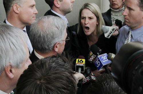 """FILE - In this Feb. 18, 2011 file photo, Sandy Fonzo of Wilkes-Barre, right, confronts former Luzerne County Judge Mark A. Ciavarella Jr., as he leaves the federal courthouse in Scranton Pa. Fonzo's son, who was jailed when he was 17 by Ciavarella, committed suicide at the age of 23. The film """"Kids for Cash"""" set to open Wednesday, Feb. 5, 2014 in Philadelphia before opening in theaters nationwide, explores the scandal that entangled thousands of children in Pennsylvania's juvenile court system and sent two former judges to prison. Ciavarella is serving a 28-year sentence and fellow ex-judge Michael Conahan 17 years for taking $2.6 million from companies looking to build and fill a youth detention center for Luzerne County. (AP Photo/The ScrantonTimes-Tribune, Michael J. Mullen, File)"""