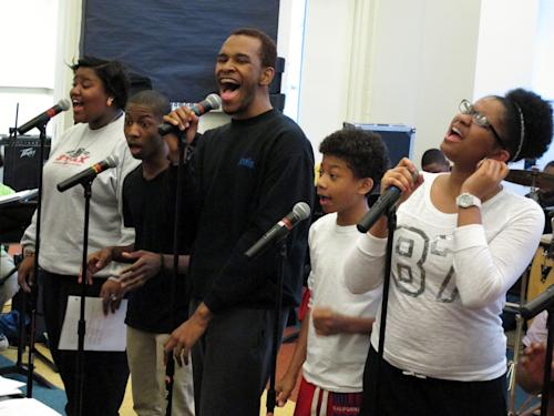 "In this March 22, 2013 photo, singers Tia Henderson, from left, Adrian Williams, Justin Hicks, Kyler Gilkey and Leah Buckley rehearse a song at Stax Music Academy in Memphis, Tenn. The Stax Music Academy is an after-school program where teenagers from some of Memphis' poorest neighborhoods learn how to dance, sing and play instruments. The academy's students play annual shows in Memphis and have toured to Washington, Italy and Australia, helping spread the soulful ""Memphis Sound."" (AP Photos/Adrian Sainz)"