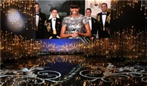 This screen grab taken from the website of Iran's semi-official Fars news agency shows an altered photo of U.S. first lady Michelle Obama presenting the best picture award at the Oscars ceremony via video link on Sunday, Feb. 24, 2013. The first lady wore a sleeveless, scoop neck gown for the occasion, but Fars ran this altered photo that covered her shoulders and neckline with added material. State TV showed images that blurred the parts of her body that were exposed. (AP Photo/Fars news agency)