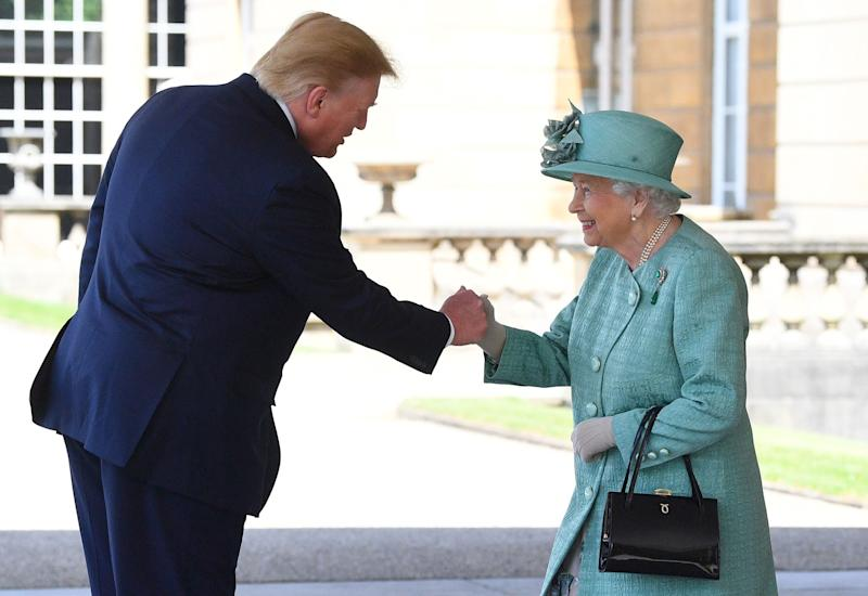 Britain's Queen Elizabeth II shakes hands with US President Donald Trump